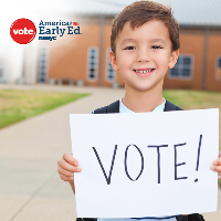 young boy with vote sign