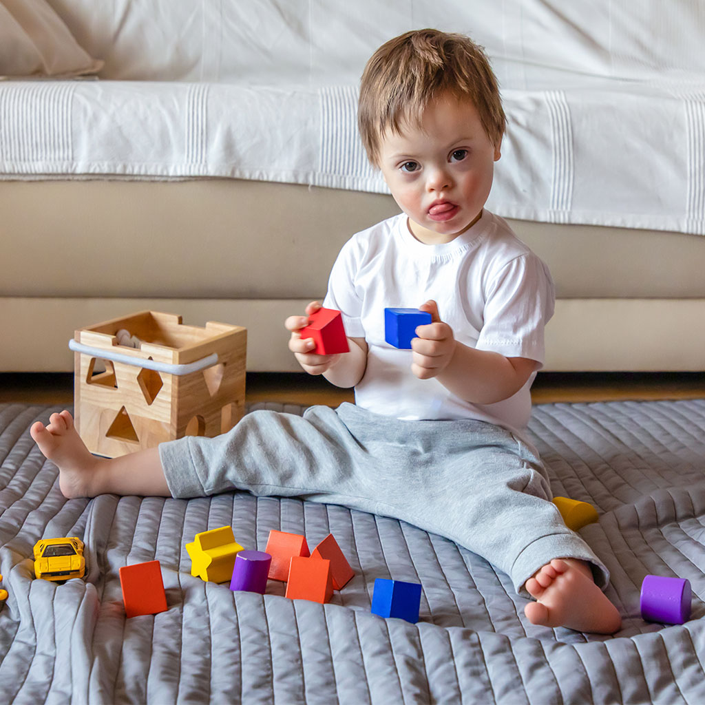 young boy playing with blocks